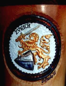 Doug Pauls' Alphorn Artwork: The Zurich Coat of Arms. The lion is in gold leaf. The sword and shield are in silver leaf.